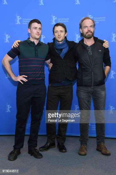 James Frecheville Lance Daly and Hugo Weaving pose at the 'Black 47' photo call during the 68th Berlinale International Film Festival Berlin at Grand...