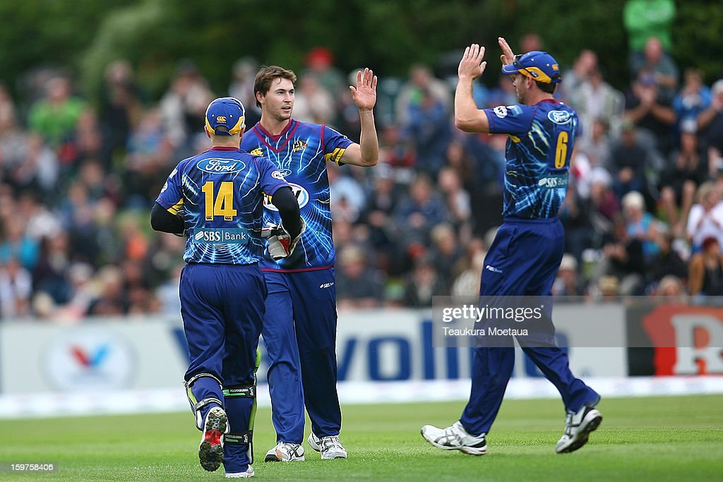 James Fuller (C) celebrates after taking a wicket during the HRV T20 Final match between the Otago Volts and the Wellington Firebirds at University Oval on January 20, 2013 in Dunedin, New Zealand.