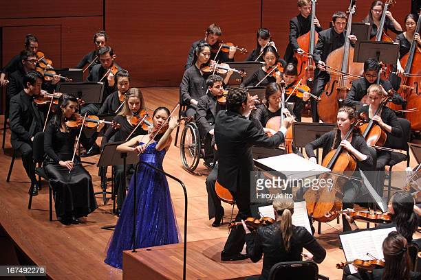 James Gaffigan leading the Juilliard Orchestra at Alice Tully Hall on Saturday night April 20 2013This imageSirena Huang performing Bartok's Violin...