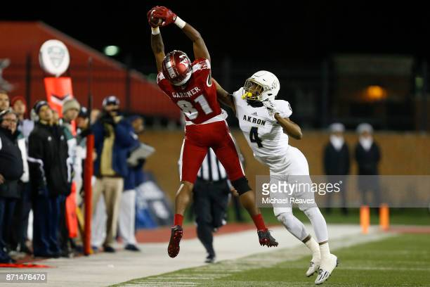 James Gardner of the Miami Ohio Redhawks makes a catch defended by Kyron Brown of the Akron Zips during the second half at Yager Stadium on November...