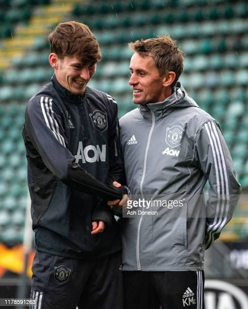 James Garner and Coach Kieran McKenna of Manchester United in action during a first team training session at AFASStadium on October 02 2019 in...
