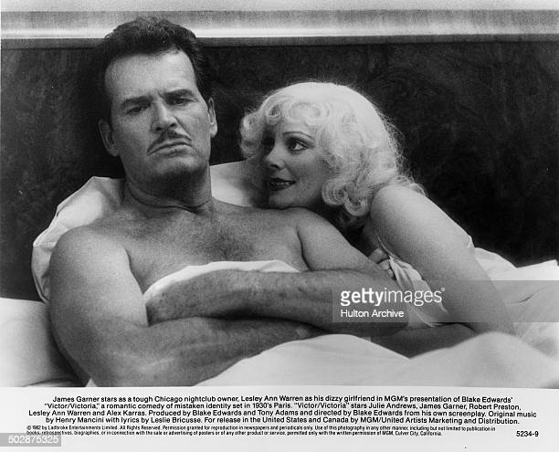 """James Garner and Lesley Ann Warren lays in bed in a scene for the MGM movie """"Victor Victoria"""" circa 1982."""