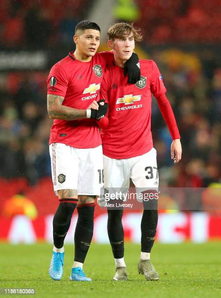 James Garner and Marcos Rojo of Manchester United celebrate victory during the UEFA Europa League group L match between Manchester United and...