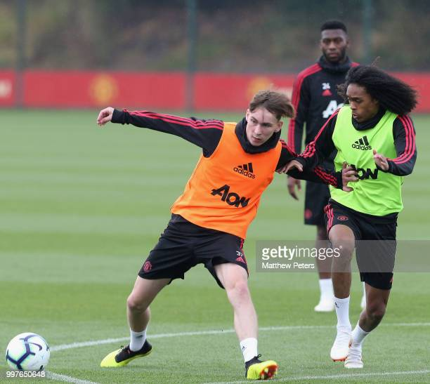 James Garner and Tahith Chong of Manchester United in action during a first team training session at Aon Training Complex on July 13 2018 in...