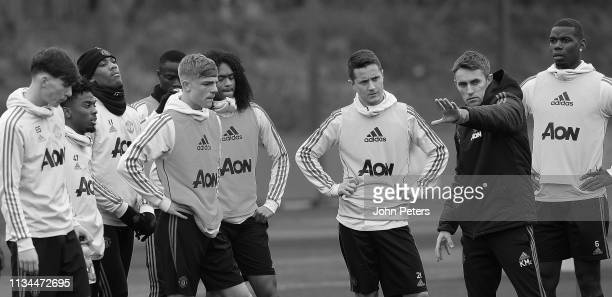 James Garner Brandon Williams Tahith Chong Ander Herrera Paul Pogba Coach Kieran McKenna of Manchester United in action during a training session at...