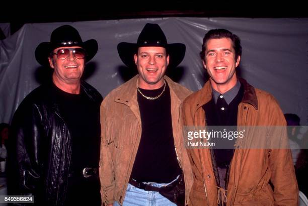 James Garner John Michael Montgomery and Mel Gibson before a video shoot for the song Amazing Grace for the soundtrack of the film 'Maverick' at Amy...