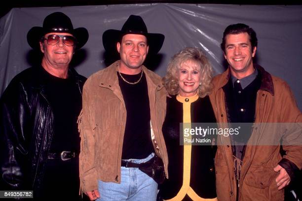 James Garner John Michael Montgomery Tammy Wynette and Mel Gibson before a video shoot for the song Amazing Grace for the soundtrack of the film...