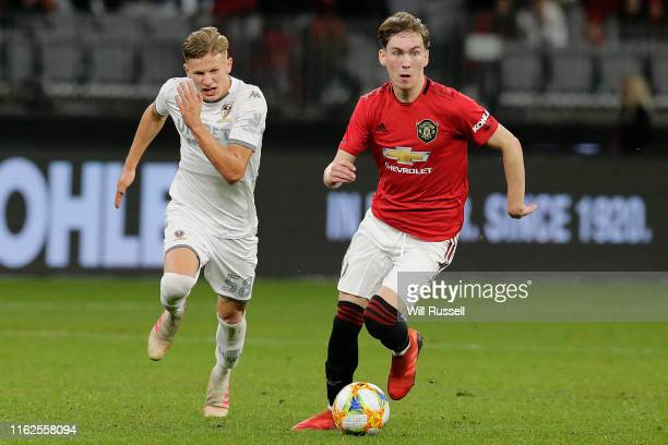 James Garner of Manchester United controls the ball during a pre-season friendly match between Manchester United and Leeds United at Optus Stadium on...