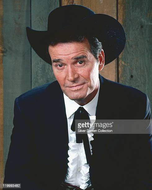 James Garner, US actor, poses in costume in a publicity portrait issued for the US television show, 'Maverick', USA, circa 1970. The western series...