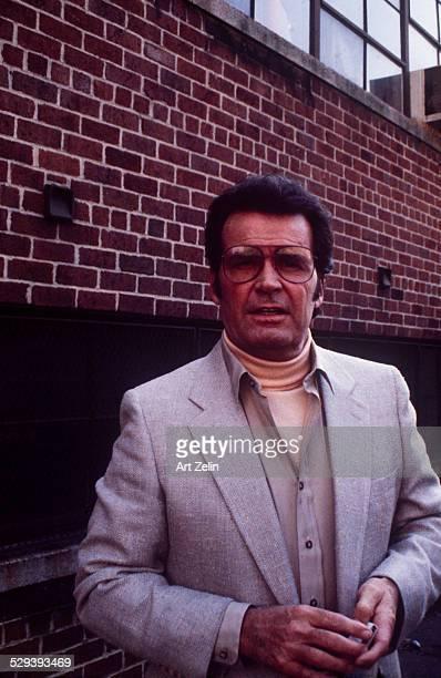 James Garner wearing a jacket and turtle neck sweater; circa 1970; New York.