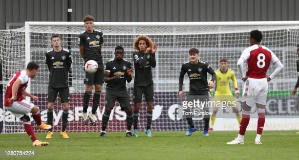 James Garner Will Fish Teden Mengi Hannibal Mejbri Mark Helm of Manchester United U23s defend a free kick during the Premier League 2 match between...