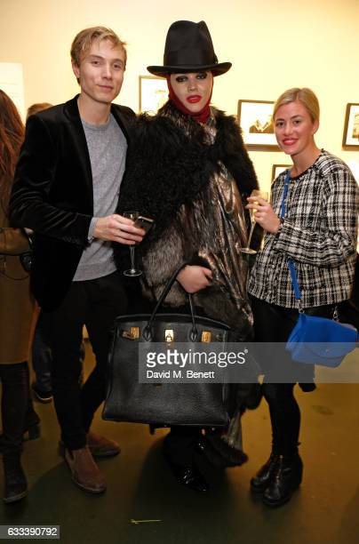 James Gartshore Boulter Daniel Lismore and guest attend a private view of 'A Paul Raymond Show' an exhibition curated by Alex Wood and India Rose...