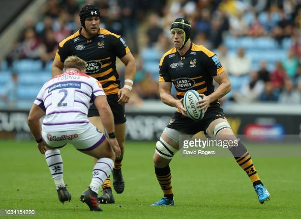 James Gaskell of Wasps takes on Tom Youngs during the Gallagher Premiership Rugby match between Wasps and Leicester Tigers at the Ricoh Arena on...