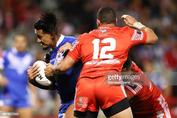 James Gavet of Samoa is tackled by the Tongan defence during the 2018 Pacific Test Invitational match between Tonga and Samoa at Campbelltown Sports...