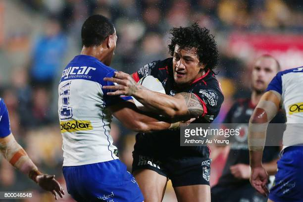 James Gavet of the Warriors charges into Will Hopoate of the Bulldogs during the round 16 NRL match between the New Zealand Warriors and the...