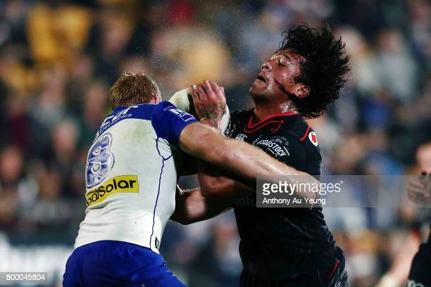 James Gavet of the Warriors clashes with Aiden Tolman of the Bulldogs during the round 16 NRL match between the New Zealand Warriors and the...