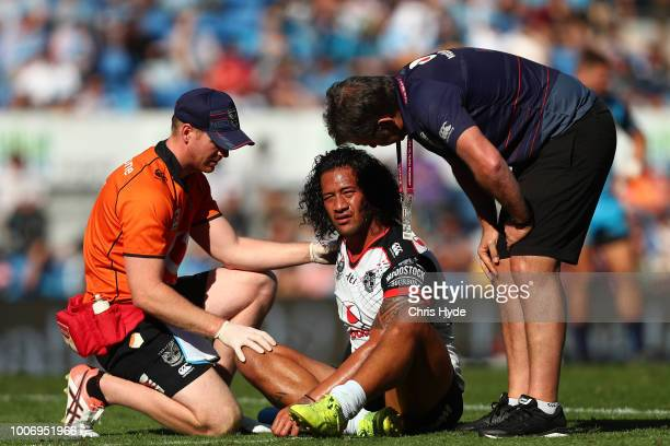 James Gavet of the Warriors is injured during the round 20 NRL match between the Gold Coast Titans and the New Zealand Warriors at Cbus Super Stadium...