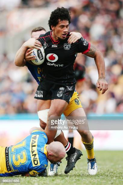 James Gavet of the Warriors is tackled by Beau Scott of the Eels during the round six NRL match between the New Zealand Warriors and the Parramatta...