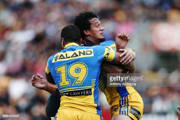 James Gavet of the Warriors is tackled by Peni Terepo of the Eels during the round six NRL match between the New Zealand Warriors and the Parramatta...
