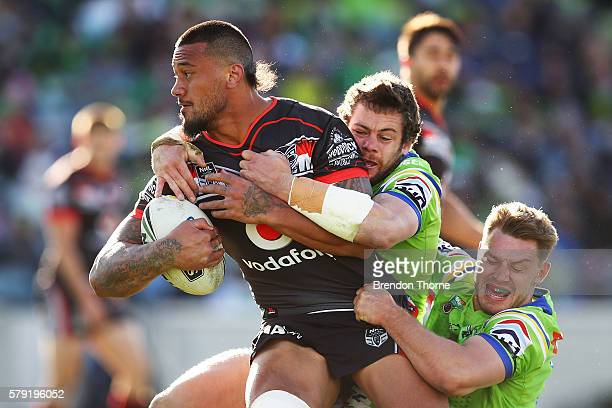 James Gavet of the Warriors is tackled by the Raiders defence during the round 20 NRL match between the Canberra Raiders and the New Zealand Warriors...