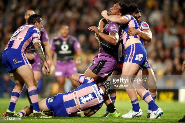 James Gavet of the Warriors is tackled during the round 22 NRL match between the New Zealand Warriors and the Newcastle Knights at Mt Smart Stadium...