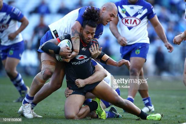 James Gavet of the Warriors is tackled during the round 23 NRL match between the Canterbury Bulldogs and the New Zealand Warriors at ANZ Stadium on...