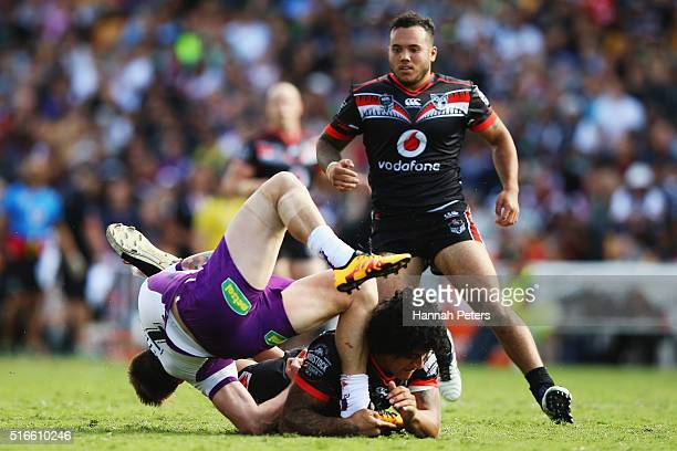 James Gavet of the Warriors tackles Cameron Munster of the Melbourne Storm during the round three NRL match between the New Zealand Warriors and the...