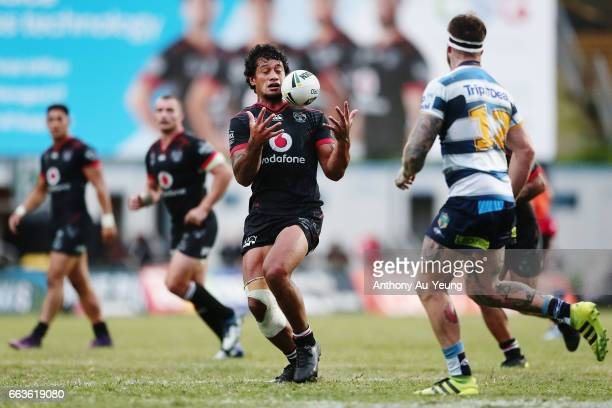 James Gavet of the Warriors tries to keep a catch under control during the round five NRL match between the New Zealand Warriors and the Gold Coast...