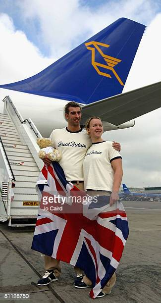 James Gibson and Melanie Marshall pose at the departure of the British Olympic Swimming Team for the 2004 Olympic Games in Athens from Heathrow...