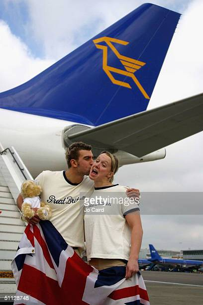 James Gibson kisses Melanie Marshall at the departure of the British Olympic Swimming Team for the 2004 Olympic Games in Athens from Heathrow Airport...