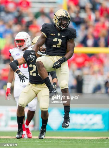 James Gibson of the Army Black Knights reacts after a stop on fourth down during the game against the Liberty Flames at Michie Stadium on September...