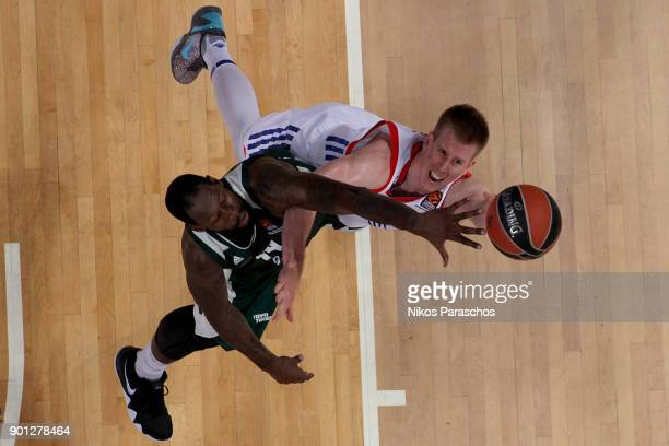 James Gist, #14 of Panathinaikos Superfoods Athens competes with Brock Motum, #12 of Anadolu Efes Istanbul during the 2017/2018 Turkish Airlines...