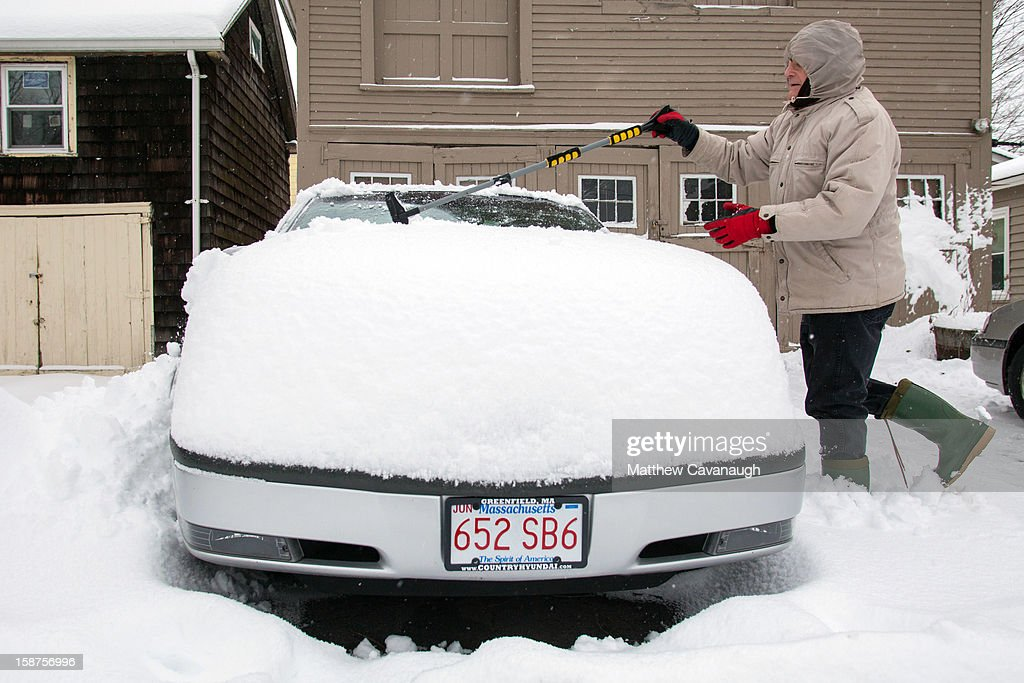 James Gliwcki of Greenfield, MA clears snow off of his car on December 27, 2012 in Greenfield, Massachusetts. A serious winter storm that caused tornados in the South on Christmas Day swept across the Northeast on Thursday, bringing snow, sleet, rain and causing dangerous travel conditions.