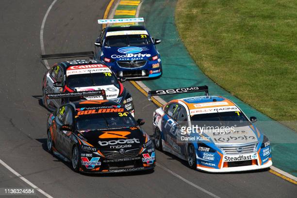 James Golding drives the Boost Mobile Racing Holden Commodore ZB and Andre Heimgartner drives the Nissan Motorsport Nissan Altima compete during the...
