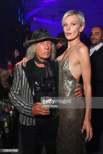 James Goldstein and a guest attend the amfAR Gala after party at La Permanente on September 22 2018 in Milan Italy