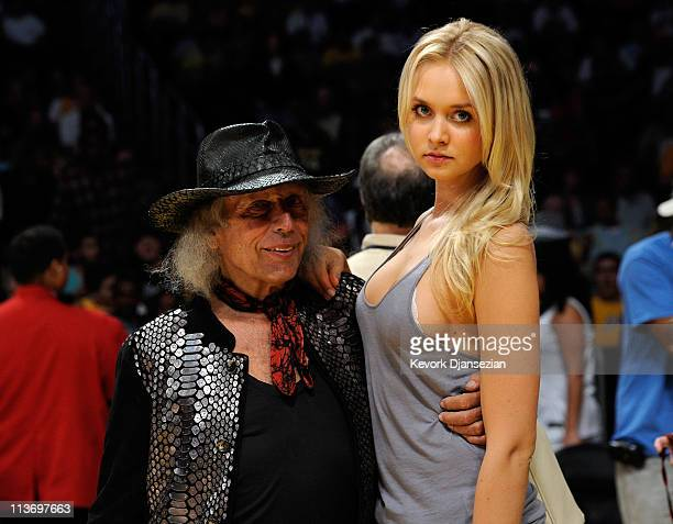 James Goldstein and Danish model Amalie Wichmann pose before Game Two of the Western Conference Semifinals in the 2011 NBA Playoffs between the Los...