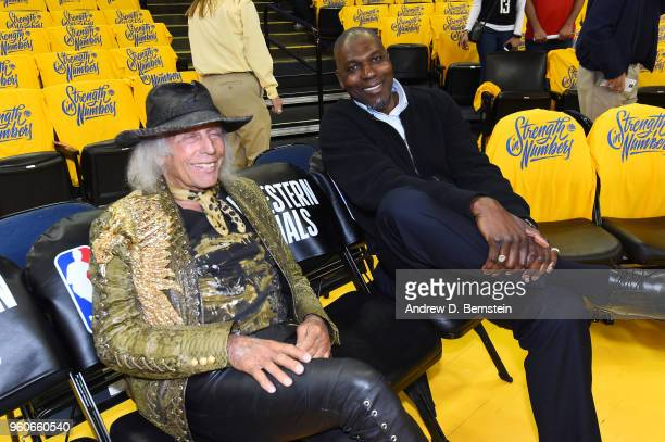 James Goldstein and Hakeem Olajuwon attend the game between the Houston Rockets and the Golden State Warriors during Game Three of the Western...