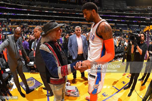 James Goldstein exchanges handshakes with Paul George of the Oklahoma City Thunder after the game against the Los Angeles Lakers on January 2 2019 at...