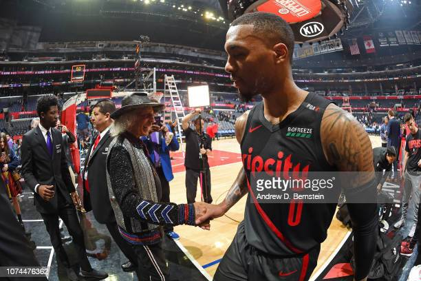 James Goldstein greets Damian Lillard of the Portland Trail Blazers before the game against the LA Clippers on December 17 2018 at STAPLES Center in...