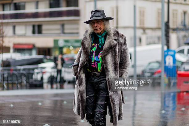 James Goldstein is seen wearing a grey fur coat a black vintage hat and black leather pants outside Anthony Vaccarello during the Paris Fashion Week...