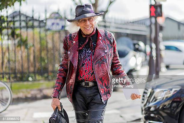 James Goldstein wearing a black vintage hat a red leather jacket and black leather pants outside Dries van Noten during the Paris Fashion Week...