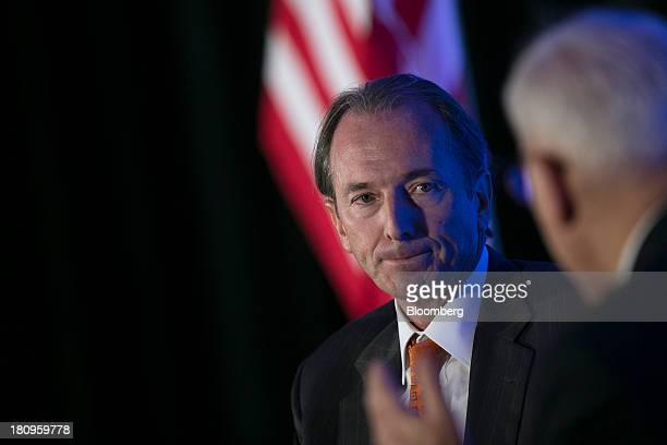 James Gorman chairman and chief executive officer of Morgan Stanley left listens to a question from David Rubenstein cofounder and cochief executive...