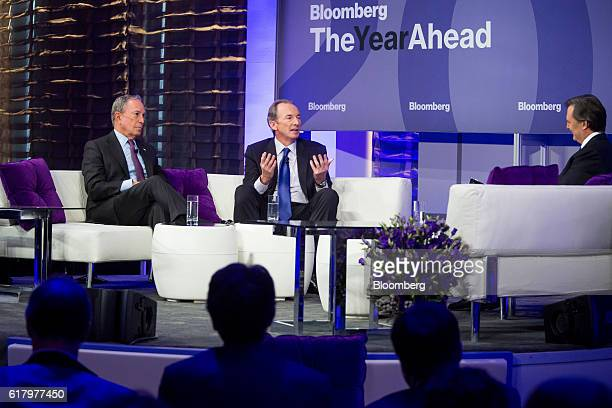 James Gorman chairman and chief executive officer of Morgan Stanley speaks center while Michael Bloomberg founder of Bloomberg LP listens during...