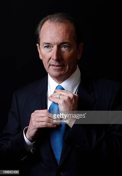 James Gorman chief executive officer of Morgan Stanley adjusts his tie while posing for a photograph after a Bloomberg Television interview on the...