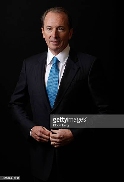 James Gorman chief executive officer of Morgan Stanley buttons his suit jacket while posing for a photograph after a Bloomberg Television interview...