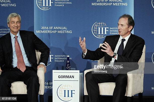 James Gorman chief executive officer of Morgan Stanley right speaks as Jamie Dimon chief executive officer of JPMorgan Chase Co smiles during a panel...