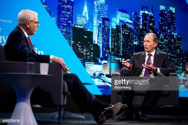 James Gorman chief executive officer of Morgan Stanley right speaks as David Rubenstein cochief executive officer of the Carlyle Group LP listens...