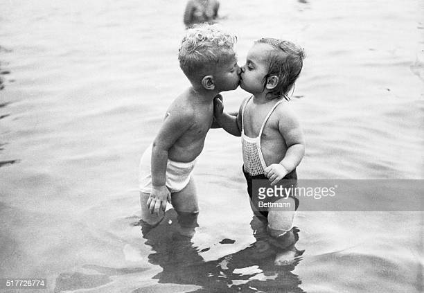James Gould and Leslie Dutka both two years old share a friendly kiss on the shores of Lake Michigan in Chicago Illinois