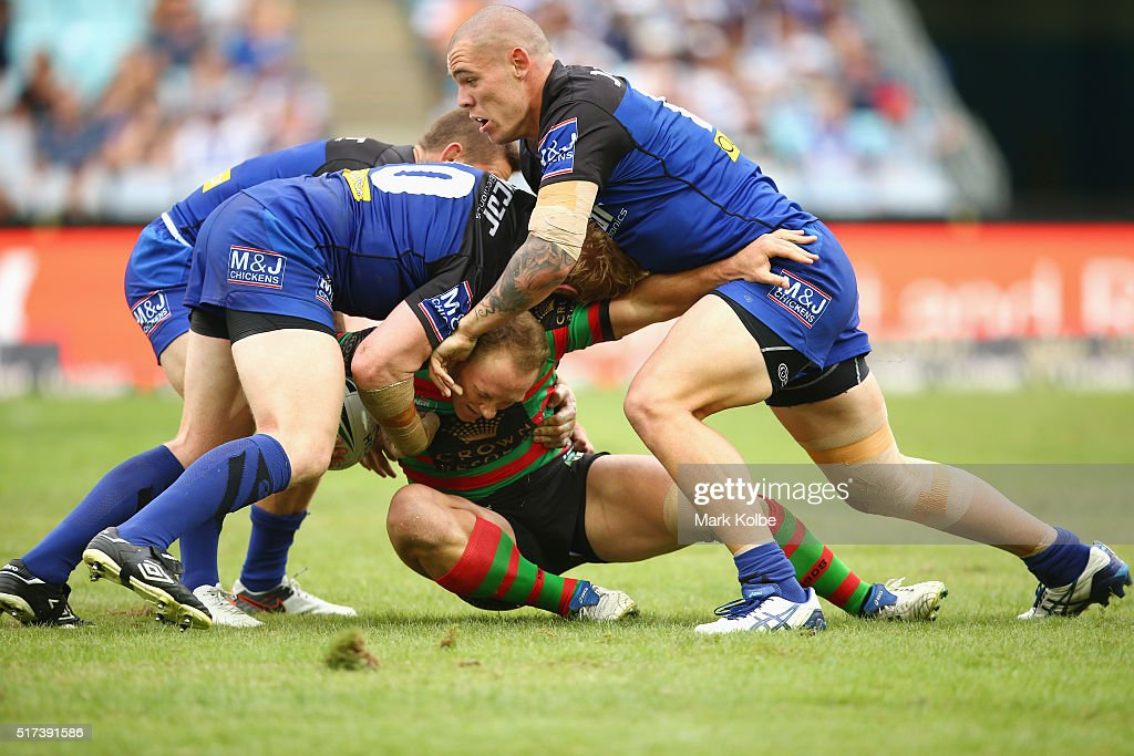 James Graham (L) and David Klemmer (R)of the Bulldogs tackle Jason Clark of the Rabbitohs during the round four NRL match between the South Sydney Rabbitohs and the Canterbury Bulldogs at ANZ Stadium on March 25, 2016 in Sydney, Australia.