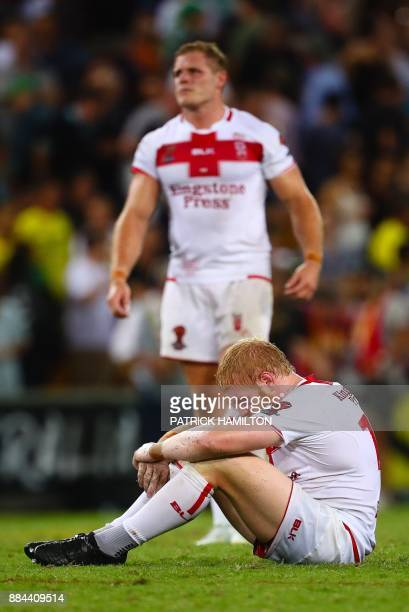 James Graham and Thomas Burgess of England react after losing to Australia following the Rugby League World Cup men's final match between Australia...